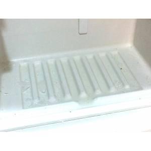 Hielo debajo de los cajones del congelador